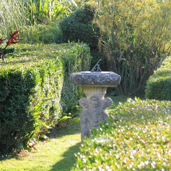 sundial surrounded by formal box hedges