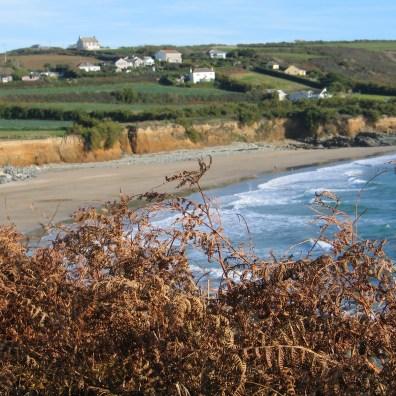 Ochre coloured cliffs frame teh sands at Perranuthnoe