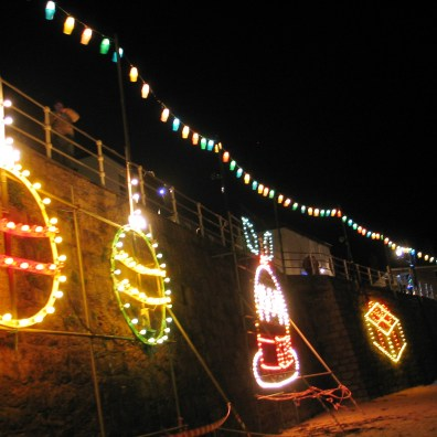 Christmas symbols on Mousehole harbour wall
