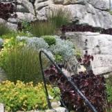 Hand rail beside a garden path