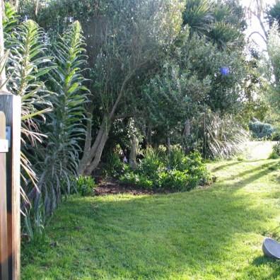 garden gate to shadowy lawn