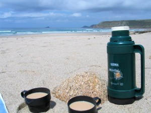 Thermos tea and empty beach the mainstay of a british picnic