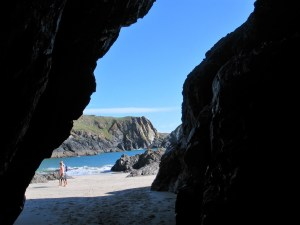 a cave view over the beach to the sea