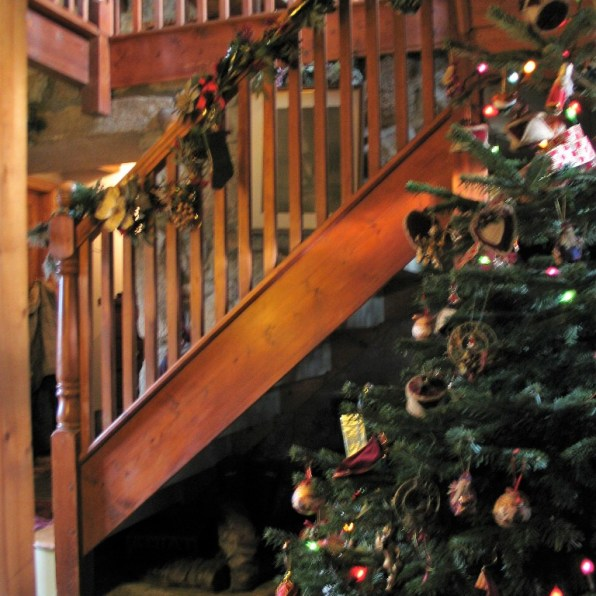 Pine staircse and beams at Ednovean Farm's old granite farmhouse