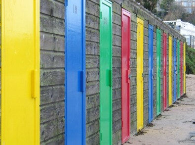 brightly coloured beach hut doors