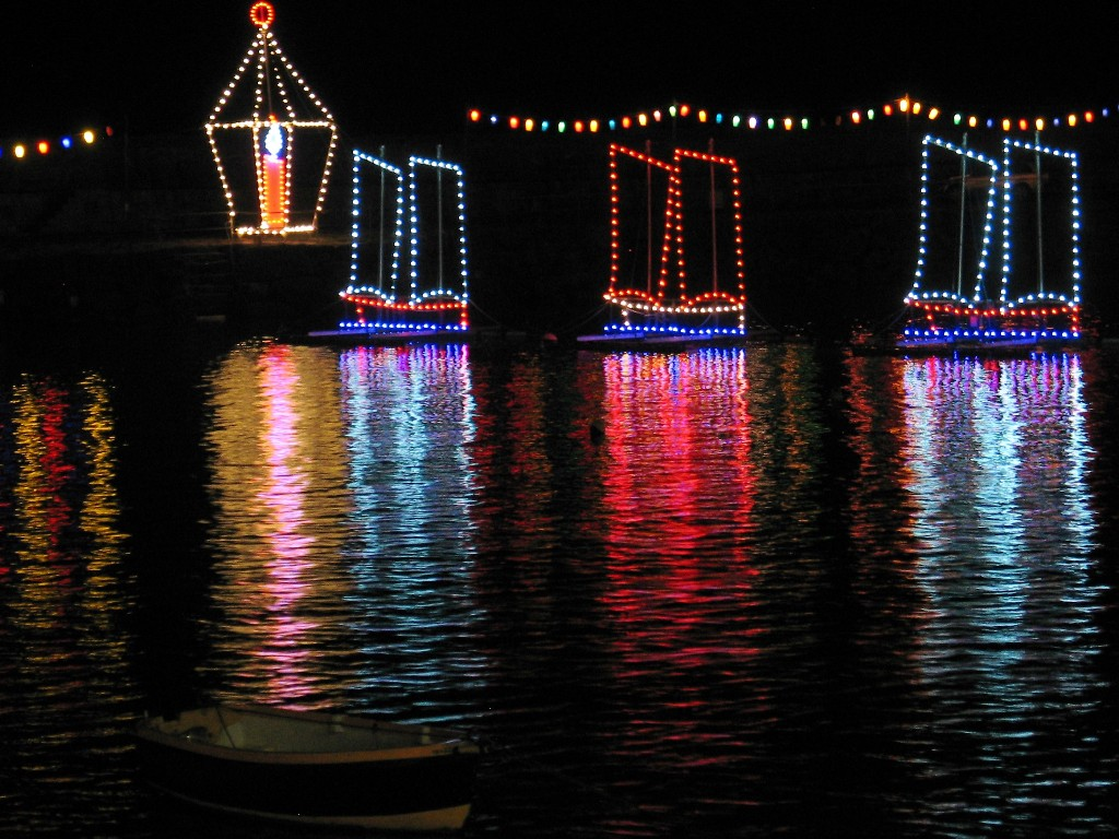 """A lone boat and christmas lights depicting """"three ships"""""""