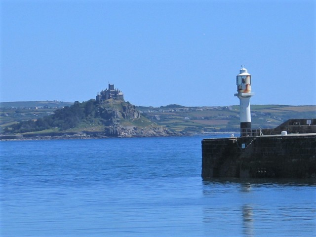 View across Penzance harbour and lighthouse to St Michael's Mount