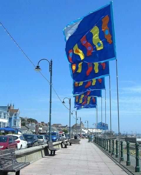 Bright silk flags flying above Penzance Promenade