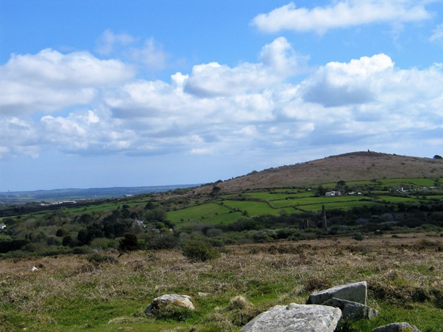 View from the top of Godolphin Hill to Tregonning hill with and old engine house in the valley between them