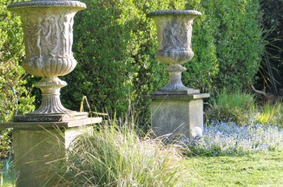 Spring light in the garden on urns set in forget-me nots - April garden diary