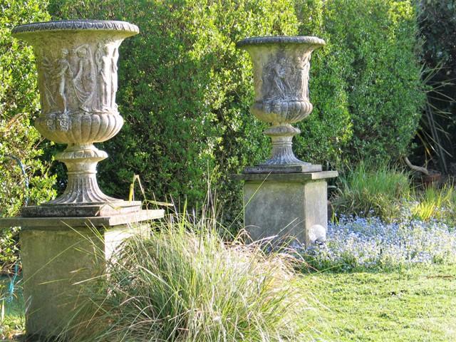 Spring light in the gardne on urns set in forget-me nots