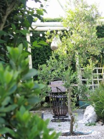 Pagoda firepit and lush plants - July Garden