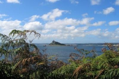 Autumn russet bracken framing ST Michael's Mount in a blue sea