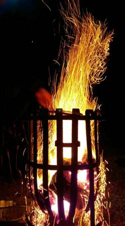 Sparks above a flaming brazier - dining outside in late autumn
