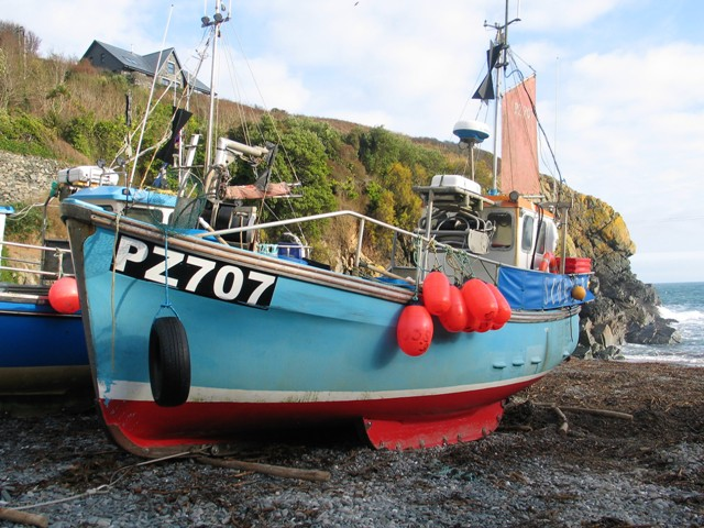 Sky Blue fishing boat on the beach - cornish crabber
