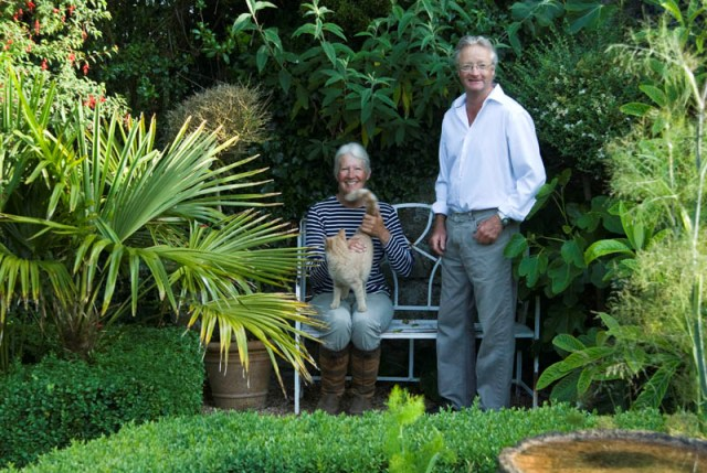 Christine & Charles Taylor sitting in courtyard garden - Ednovean Farm