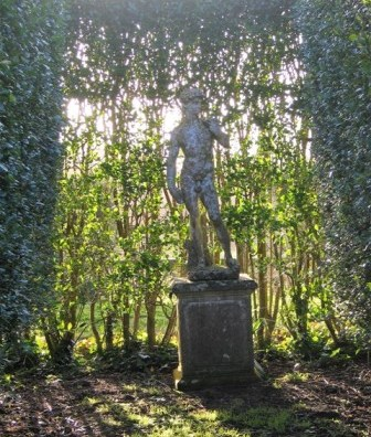 Statue of David in leafy bower