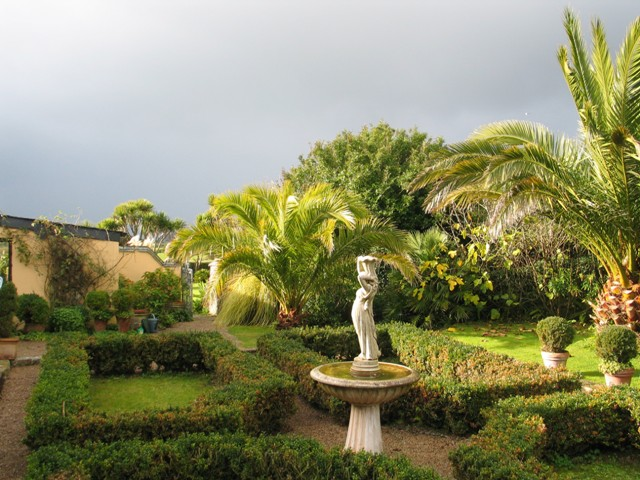 Formal garden with stormy November sky