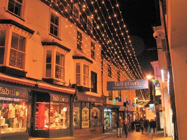 Christmas lights over cobbled street