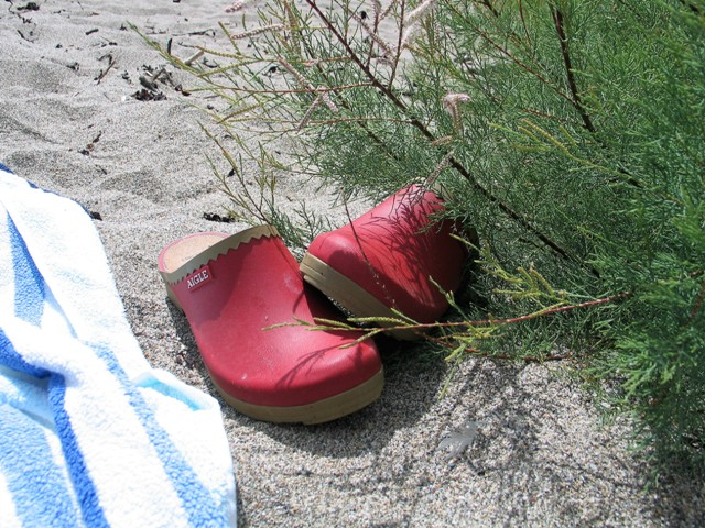 Summer dreams - remembering Shoes kicked off on a sandy beach on a summer day