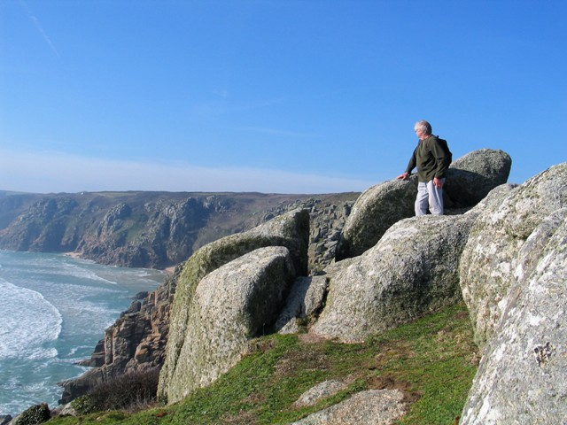 Charles clambered up on of the rocky outcrops