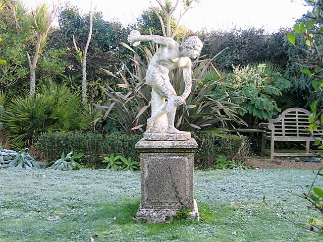 The breath of early spring Frost in the Italian garden - discus thrower