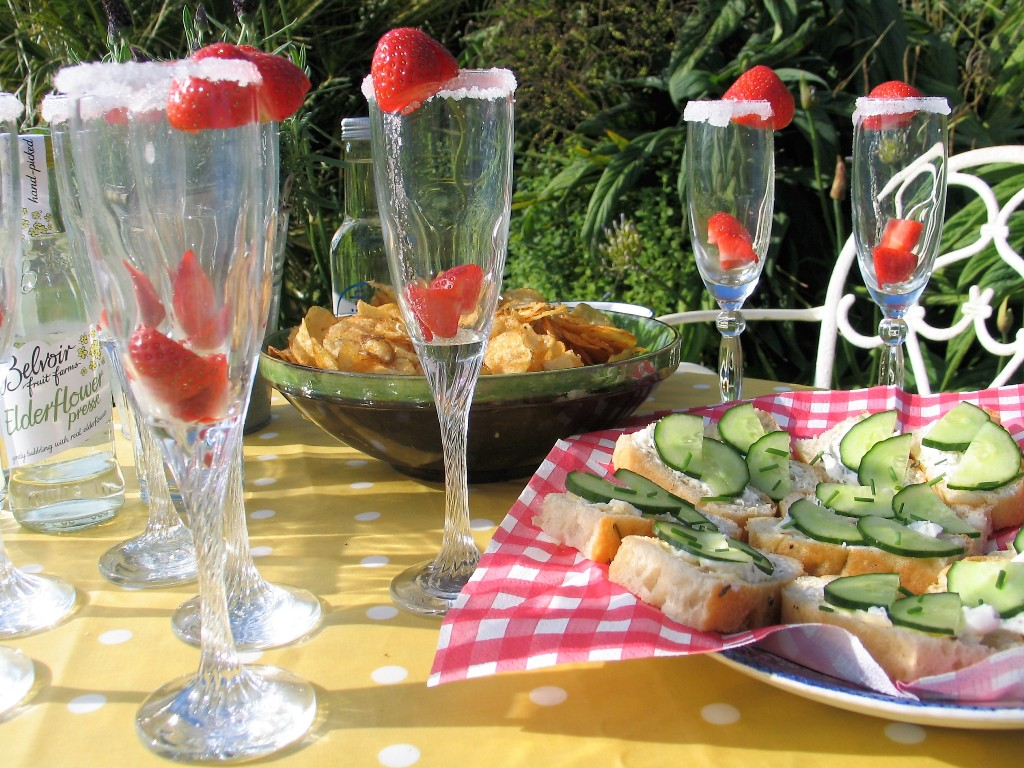 Champagne flutes and rustic canapes ready for a summer evening