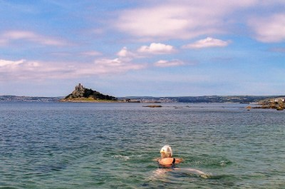 swimming in clear seas below St Michael's Mount
