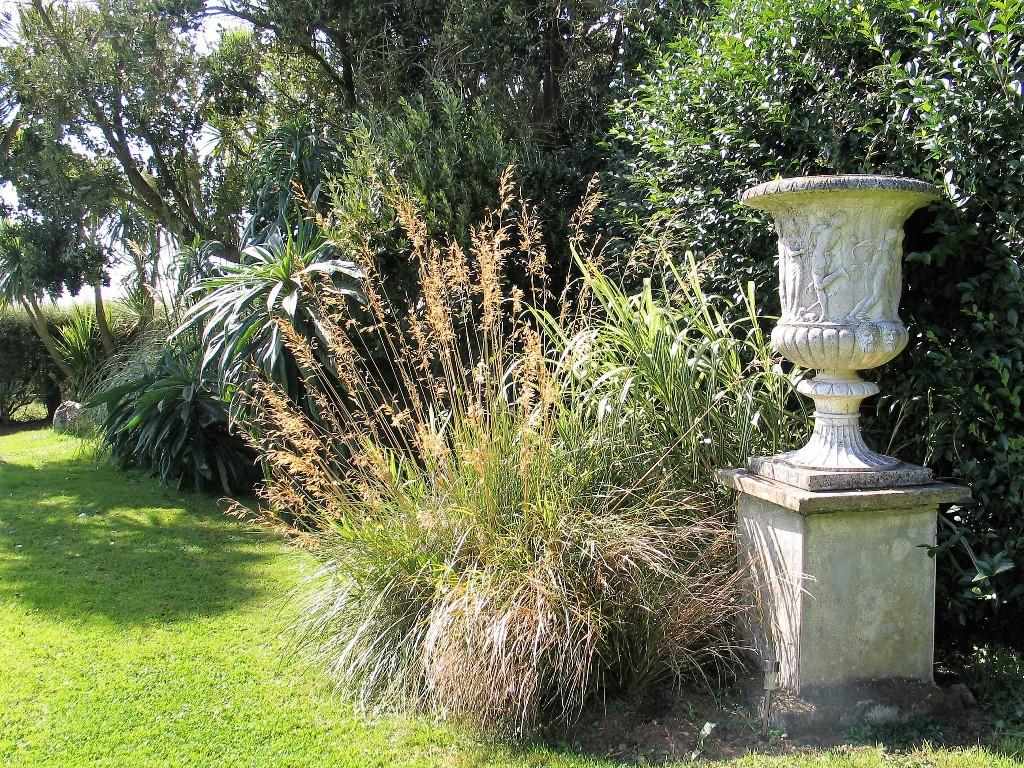Formal urn flanked by golden oat grass - garden diary