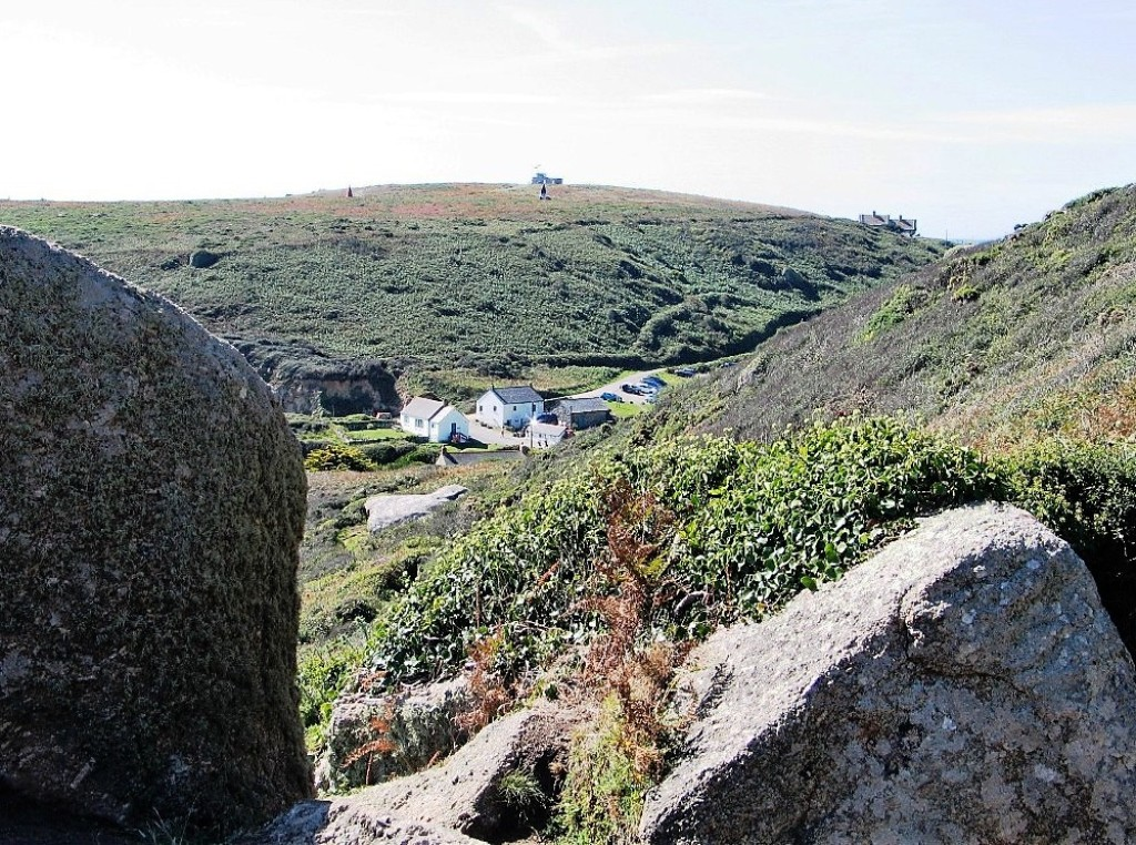 The hamlet of Porthgwarra tucked in  cleft of the hills