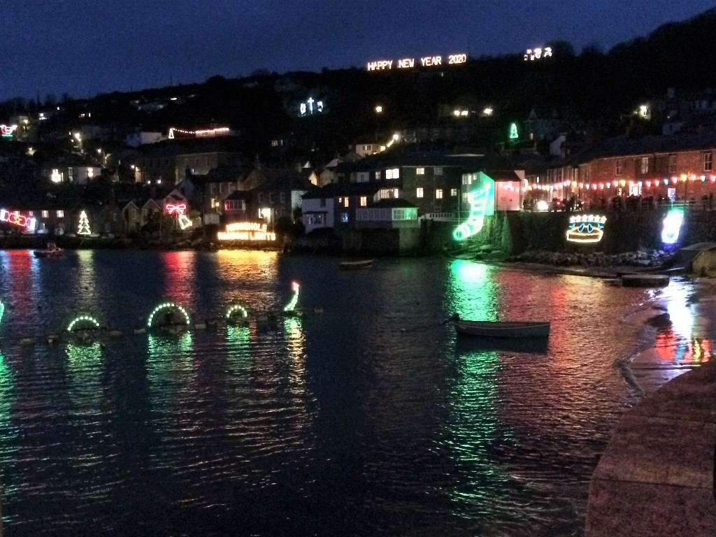 Cornish harbour with Crhistmas lights perfect spot to enjoy a pub supper Mousehole in West Cornwall