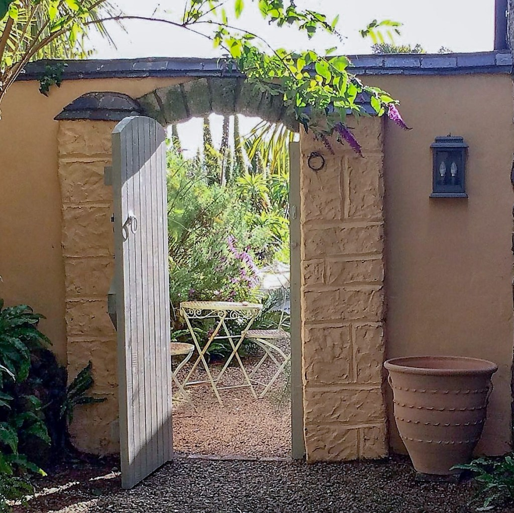 Secluded garden entrance with Mediterranean style