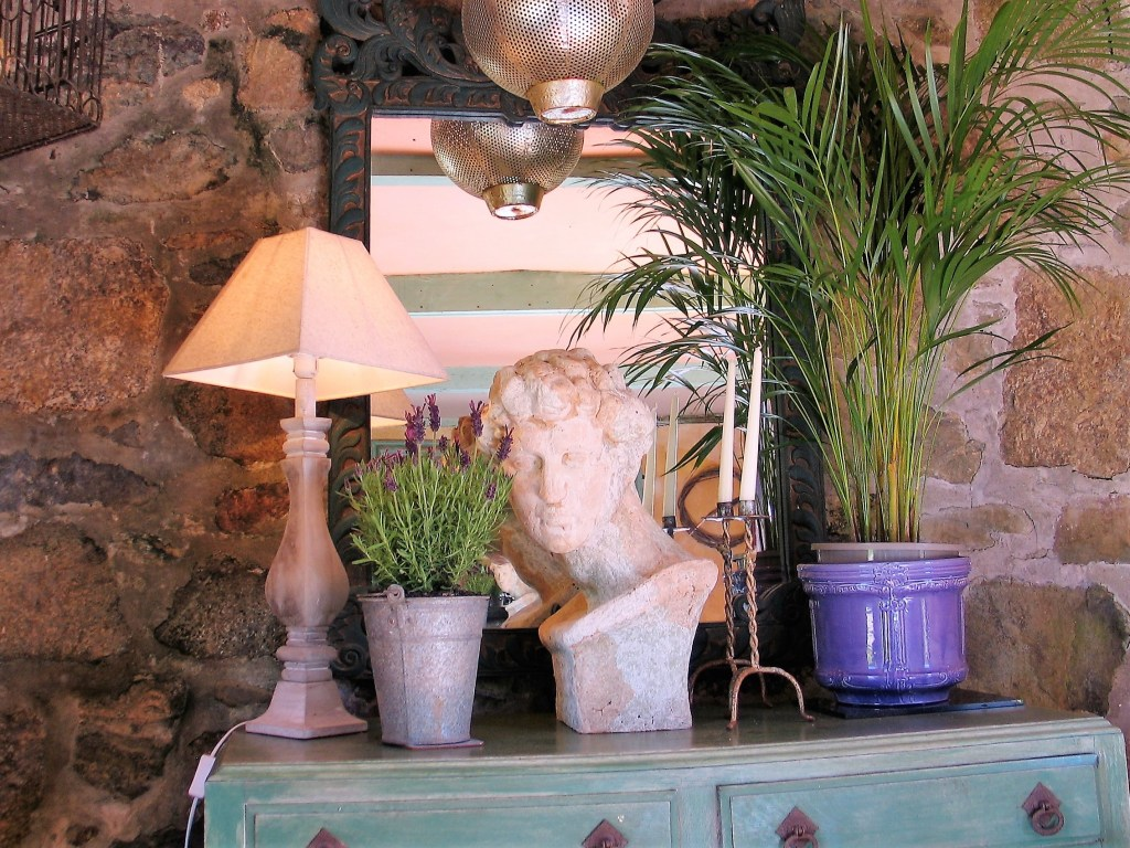 upcycled sideboard with house plants