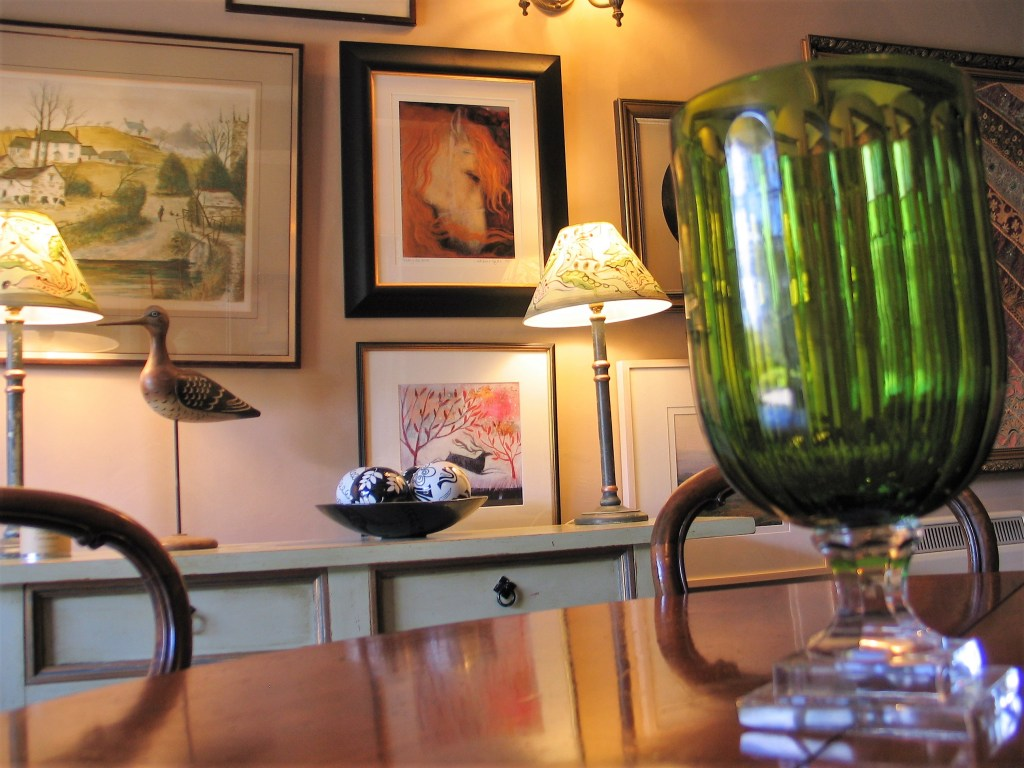 Breakfast room view across an antique table to modern artist  Catherine Hyde