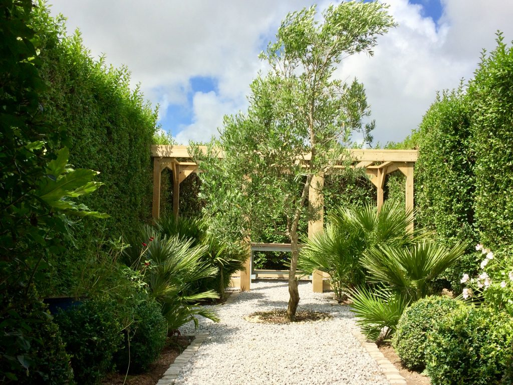 Ednovean - formal garden arbour in sub tropical setting