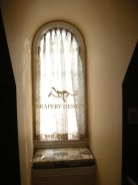 Arched panels with pinch pleated header