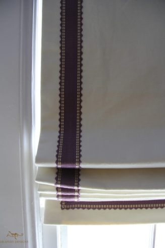 Black out lined roman shades with contrast trim on edges