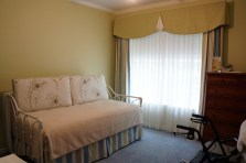 Green valance with matching curtain and bed skirt