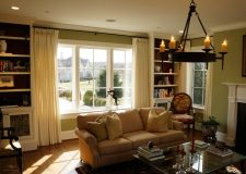 """lined white panels on 1"""" metal rods in family room."""