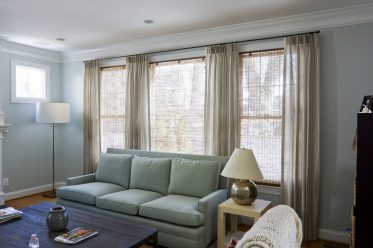 Family room beige curtains on small metal rods