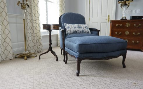 Custom upholstered armchair and ottoman 01