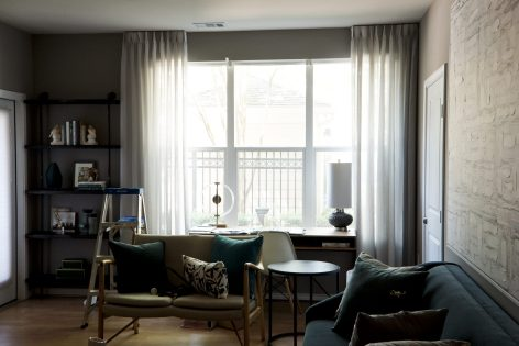 White sheer curtain on Ceiling mounted rods,