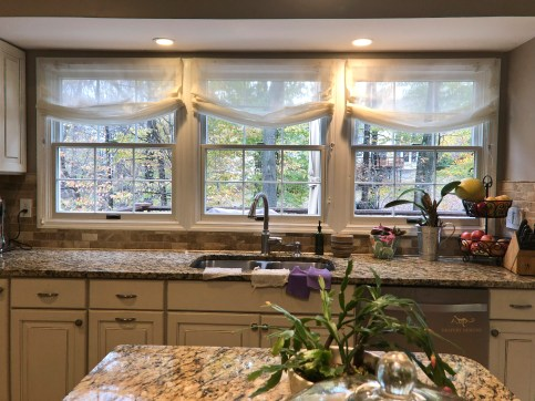 Relaxed roman shades with white sheer lining