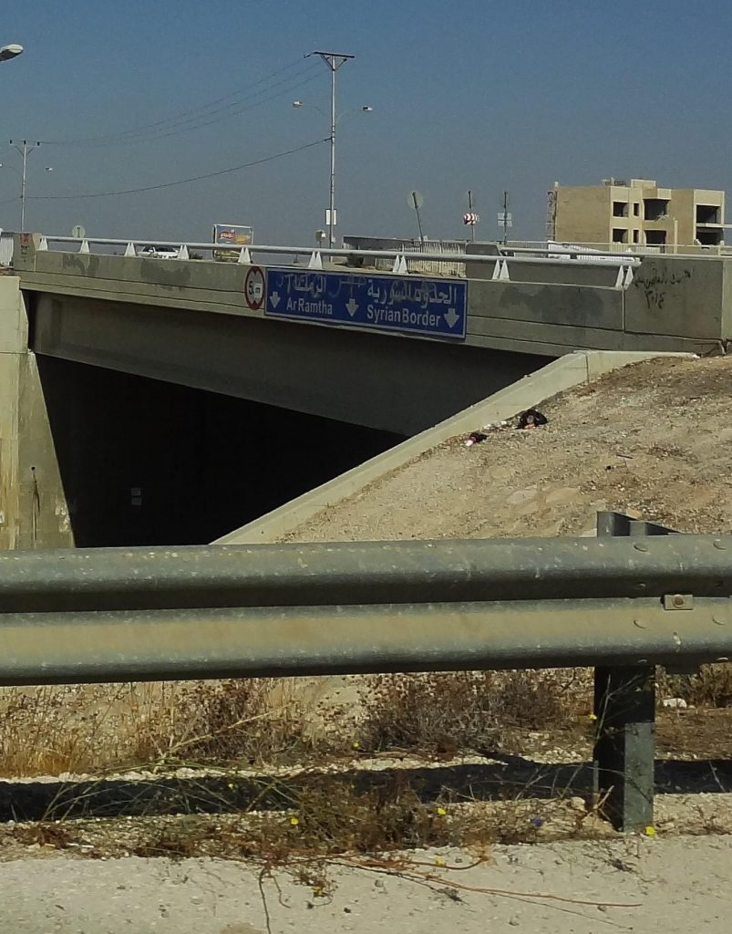 Highway sign for the Syrian border, just 30 minutes away.
