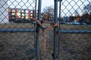 Metal gates locked with a rusty chain and lock