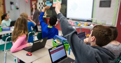 The image above shows students learning in a classroom.