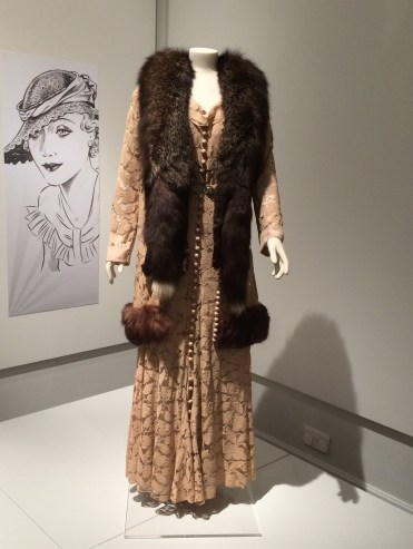 Lace embroided dress and matching coat with fur trim