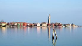 Burano the fihermen's island floats mysteriously in the Venetian Lagoon
