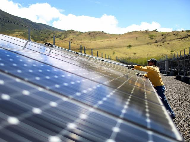 Solar panels, including this one in Guanacaste, Costa Rica, produce a small portion of the renewable energy