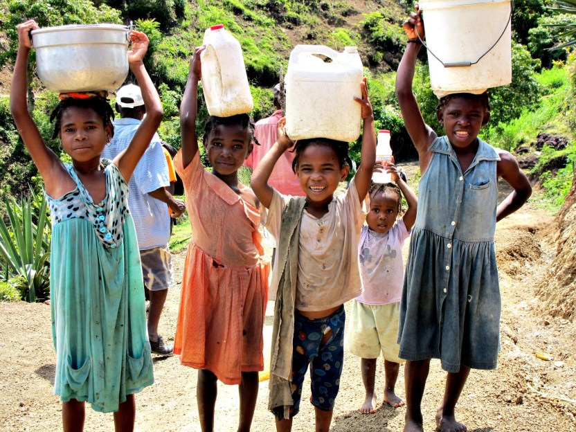 Children-Carrying-Water-On-Their-Head